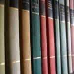 dusting bookshelves